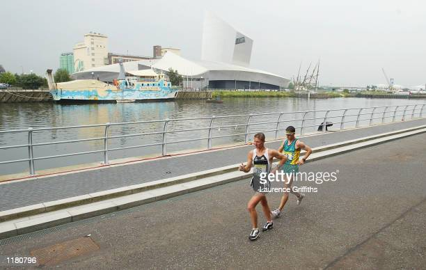 Craig Barrett of New Zealand and Nathan Deakes of Australia lead the Mens 50 kilometers walk in Salford Quays in Manchester England on JULY 30 2002