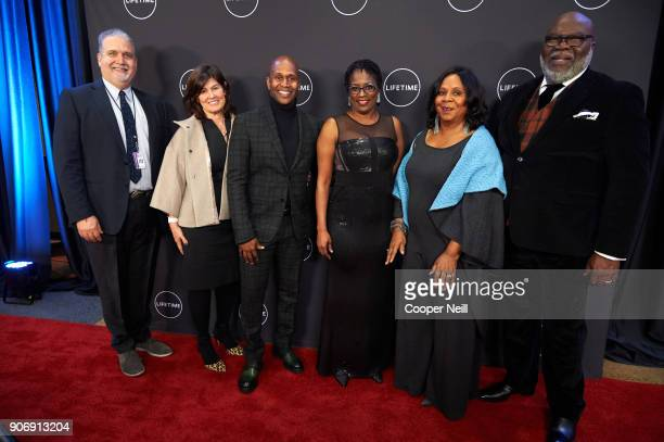 """Craig Baumgarten, Tanya Lopez, Derrick Williams, Antoinette Tuff, Serita Jakes and Bishop T.D. Jakes pose for a photo during the premiere of """"Faith..."""
