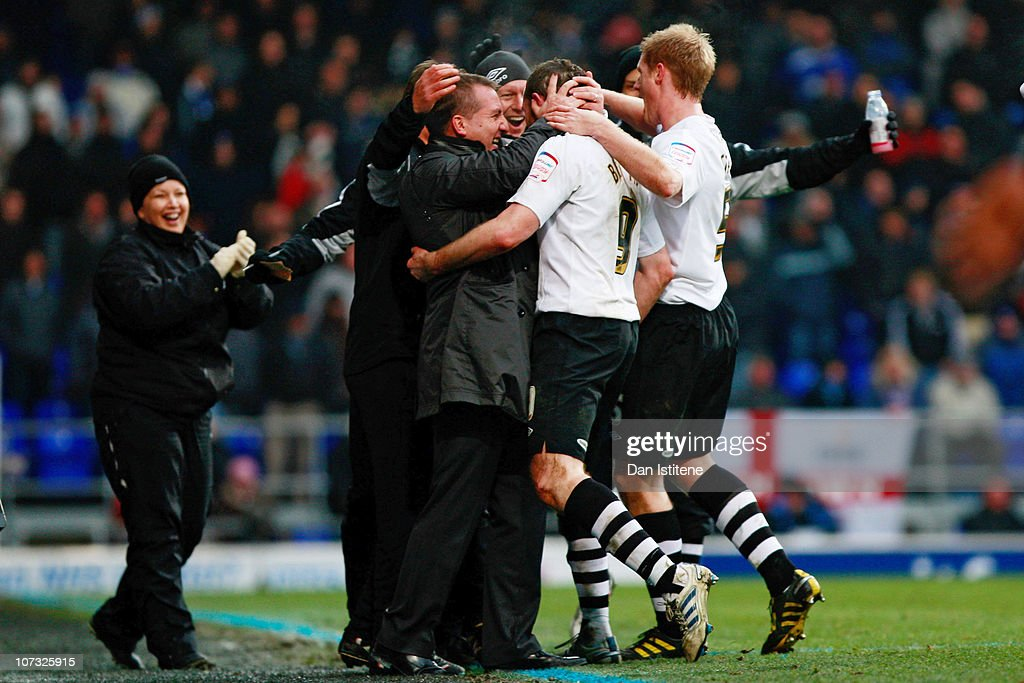 Craig Beattie (2nd R) of Swansea celebrates with his manager Brendan Rodgers after scoring his team's third goal during the npower Championship match between Ipswich Town and Swansea City at Portman Road on December 4, 2010 in Ipswich, England.