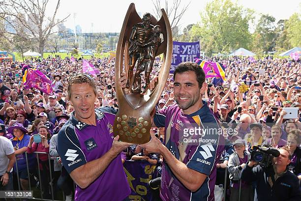 Craig Bellamy and Cameron Smith of the Storm shows the trophy to the crowd during the Melbourne Storm NRL Grand Final celebrations at Gosch's Paddock...
