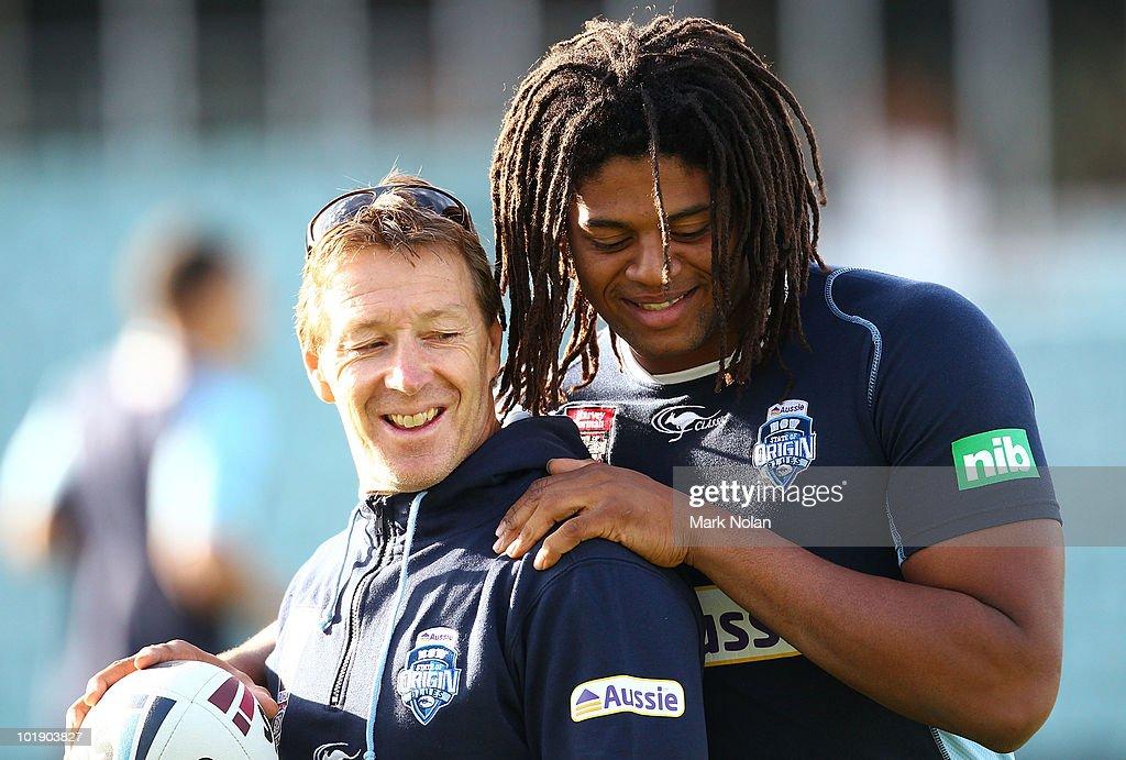 Craig Bellamy and Jamal Idris of the Blues share a joke during a New South Wales Blues Origin training session at Parramatta Stadium on June 9, 2010 in Sydney, Australia.