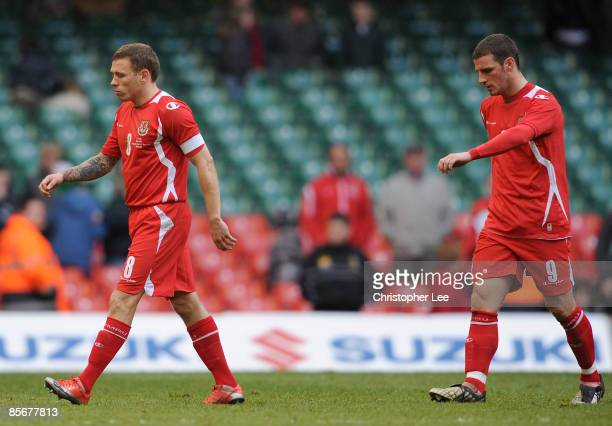 Craig Bellamy and Jason Koumas of Wales leave the field looking dejected during the FIFA 2010 World Cup Qualifier Group 4 match between Wales and...