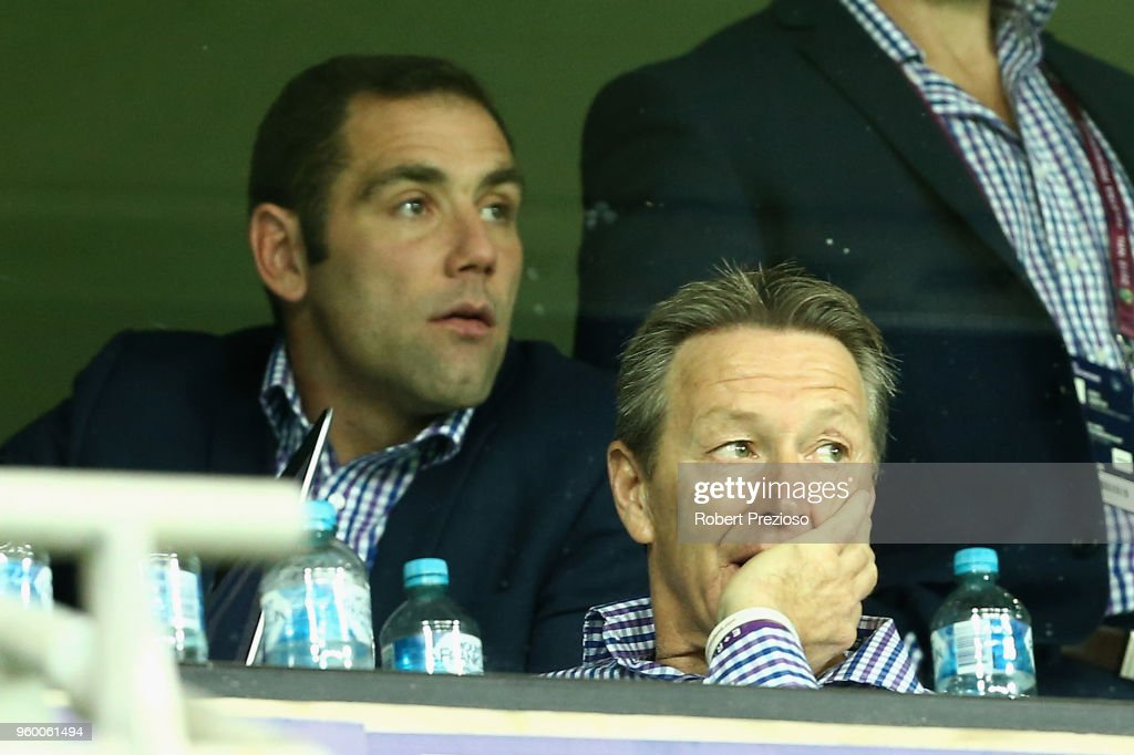 Craig Bellamy coach of the Melbourne Storm looks on along with Cameron Smith (L) during the round 11 NRL match between the Melbourne Storm and the Manly Sea Eagles at AAMI Park on May 19, 2018 in Melbourne, Australia.