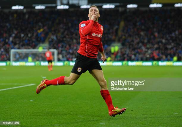 Craig Bellamy of Cardiff City celebrates as he scores their first goal during the Barclays Premier League match between Cardiff City and Norwich City...