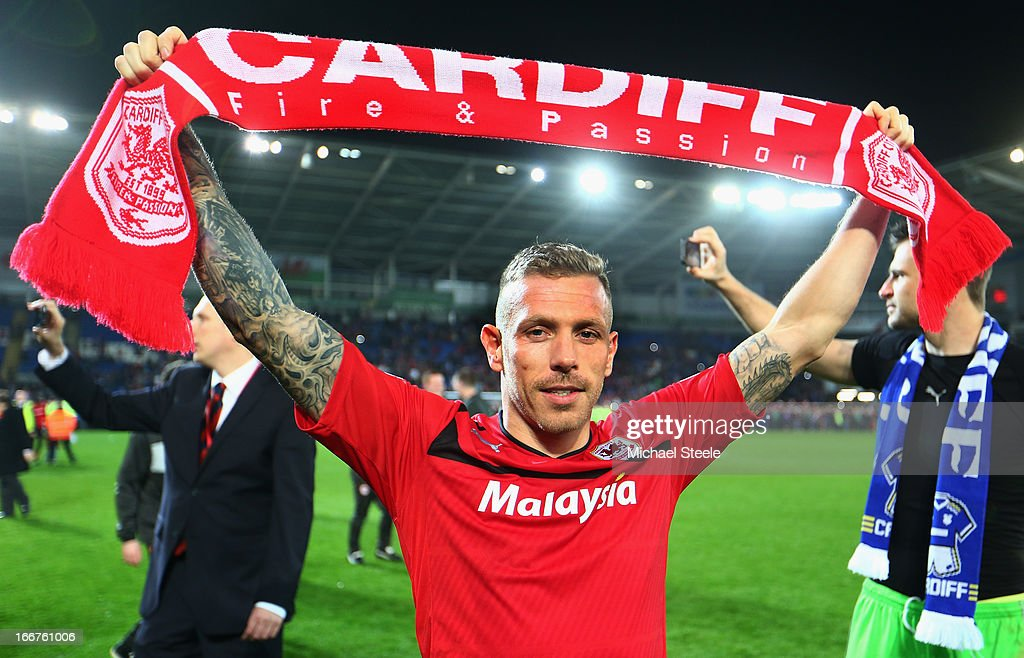 Craig Bellamy of Cardiff City celebrates his team's promotion to the Premier League at the end of the npower Championship match between Cardiff City and Charlton Athletic at the Cardiff City Stadium on April 16, 2013 in Cardiff, Wales.