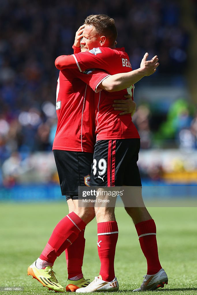 Craig Bellamy (R) of Cardiff City celebrates with Peter Whittingham (L)after scoring the opening goal during the Barclays Premier League match between Cardiff City and Chelsea at Cardiff City Stadium on May 11, 2014 in Cardiff, Wales.