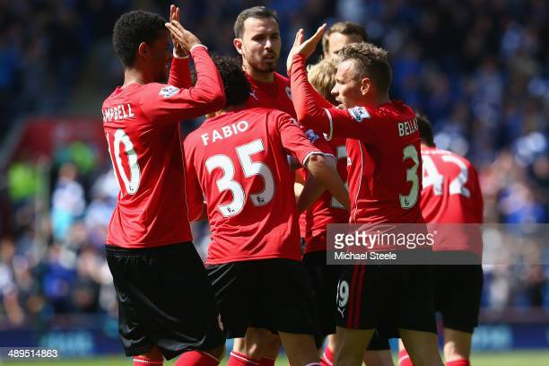 Craig Bellamy of Cardiff Citycelebrates with Fraizer Campbell after scoring the opening goal during the Barclays Premier League match between Cardiff...