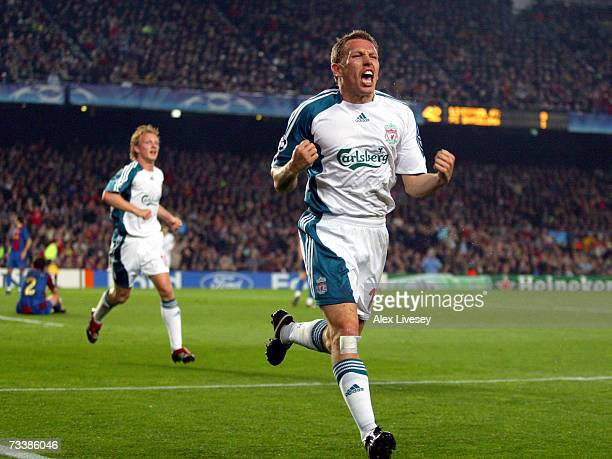Craig Bellamy of Liverpool celebrates after scoring his goal during the UEFA Champions League round of 16 first leg match between Barcelona and...