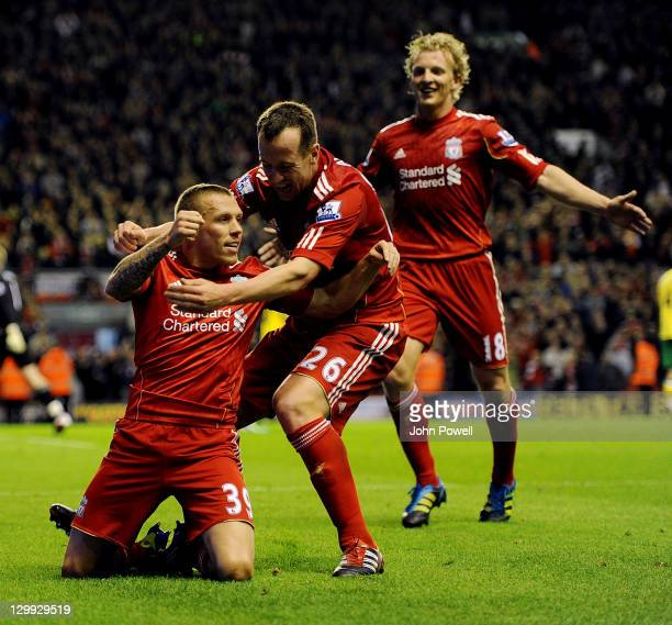 Craig Bellamy of Liverpool celebrates after scoring the opening goal during the Barclays Premier League match between Liverpool and Norwich City at...