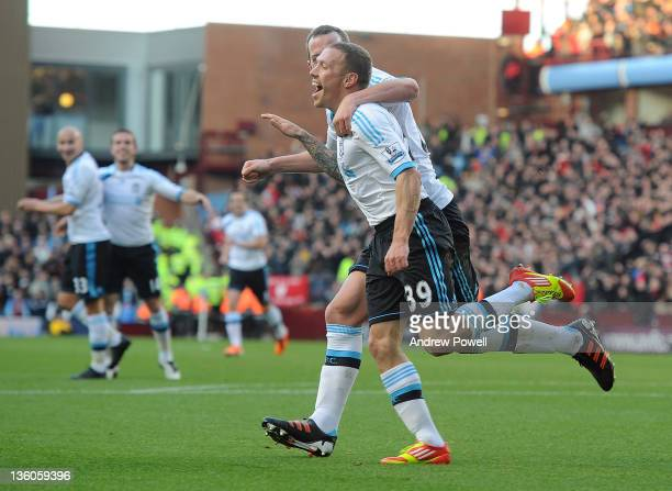Craig Bellamy of Liverpool celebrates after scoring the opening goal during the Barclays Premier League match between Aston Villa FC and Liverpool FC...