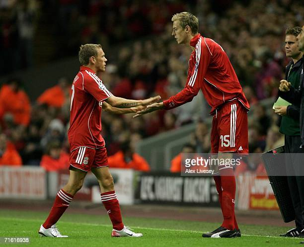 Craig Bellamy of Liverpool is substituted for team mate Peter Crouch during the UEFA Champions League third qualifying round 1st leg match between...
