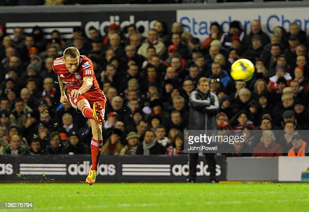 Craig Bellamy of Liverpool scores the second during the Barclays Premier League match between Liverpool and Newcastle United at Anfield on December...