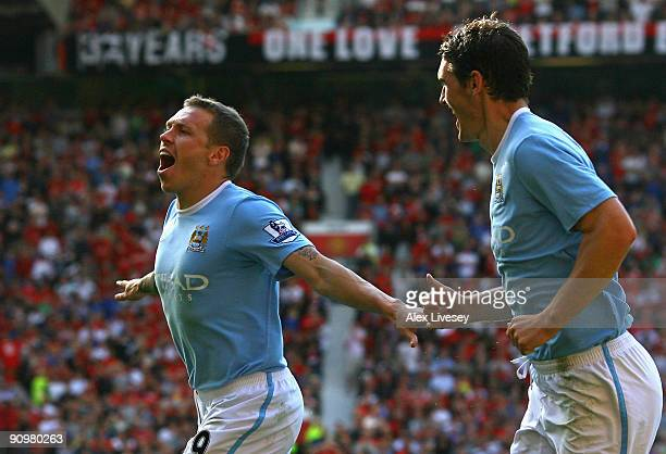 Craig Bellamy of Manchester City celebrates scoring his team's second goal with team mate Gareth Barry during the Barclays Premier League match...