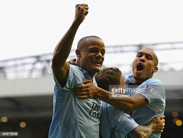 Craig Bellamy of Manchester City is mobbed by his team mates Vincent Kompany and Nigel de Jong after scoring the opening goal during the Barclays...