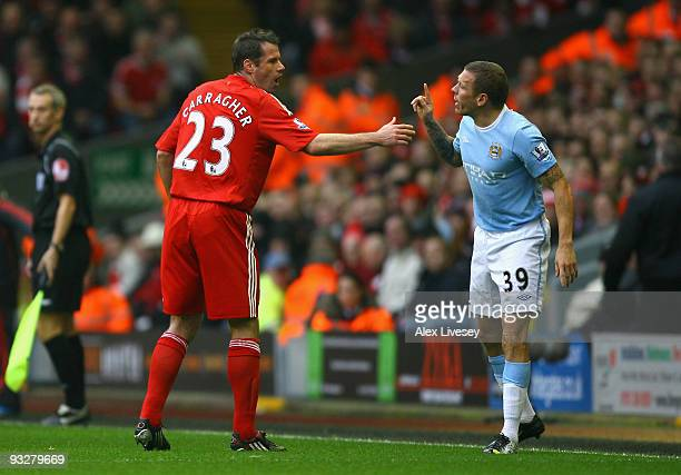 Craig Bellamy of Manchester City rejects the hand of Jamie Carragher of Liverpool during the Barclays Premier League match between Liverpool and...