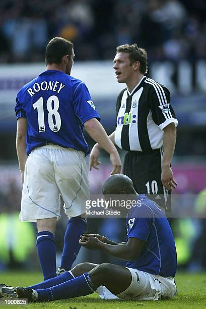 Craig Bellamy of Newcastle confronts Wayne Rooney after Kevin Campbell of Everton was awarded a penalty during the FA Barclaycard Premiership match...