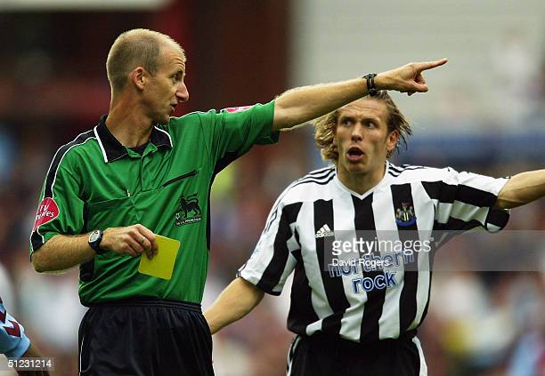 Craig Bellamy of Newcastle United argues with referee Mike Riley after a contraversial decision went against Newcastle during the Barclays...