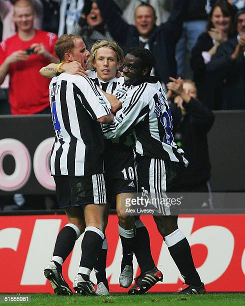 Craig Bellamy of Newcastle United celebrates his winning goal with Nicky Butt and Olivier Bernard during the Barclays Premiership match between...