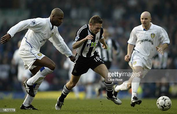Craig Bellamy of Newcastle United takes the ball past Michael Duberry of Leeds United during the FA Barclaycard Premiership match held on February 22...