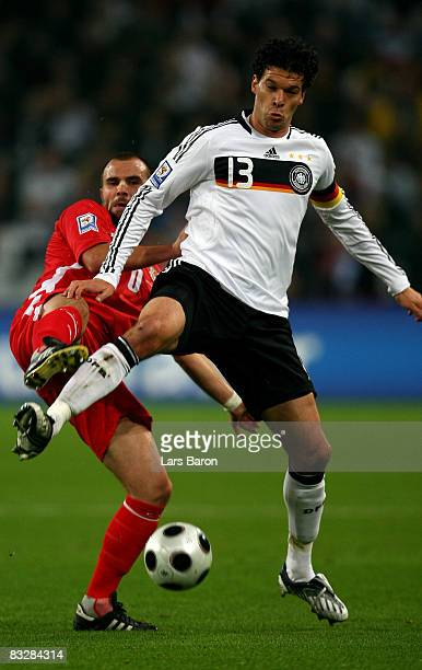 Craig Bellamy of Wales challenges Michael Ballack of Germany for the ball during the FIFA 2010 World Cup Qualifier match between Germany and Wales at...