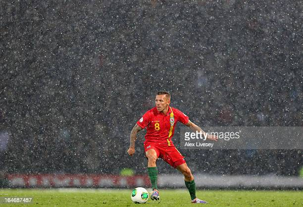 Craig Bellamy of Wales is seen in action during a snow storm in the FIFA 2014 World Cup Group A qualifying match between Scotland and Wales at...
