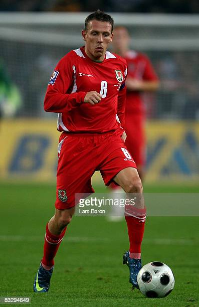 Craig Bellamy of Wales runs with the ball during the FIFA 2010 World Cup Qualifier match between Germany and Wales at the Borussia Park on October 15...