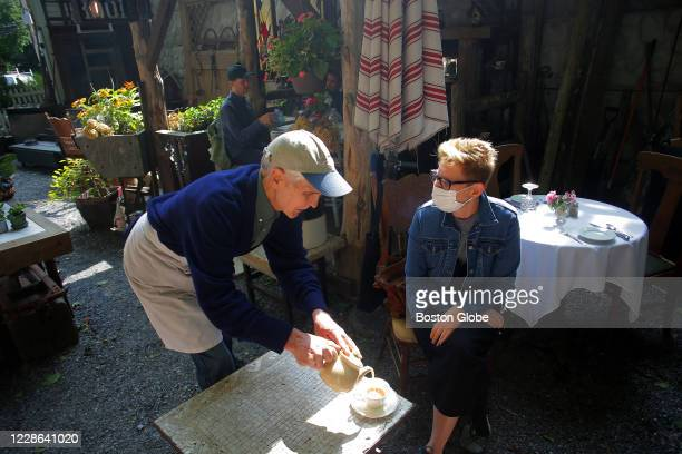 Craig Bero serves tea to a customer in Housatonic MA on Sept 15 2020 Craig Bero who grew up on a farm in northern Wisconsin and has spent 30 years in...
