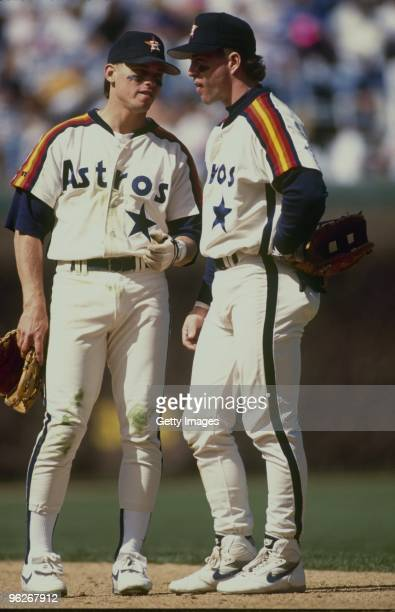 Craig Biggio and Jeff Bagwell of the Houston Astros talk on the field during a 1992 season game.