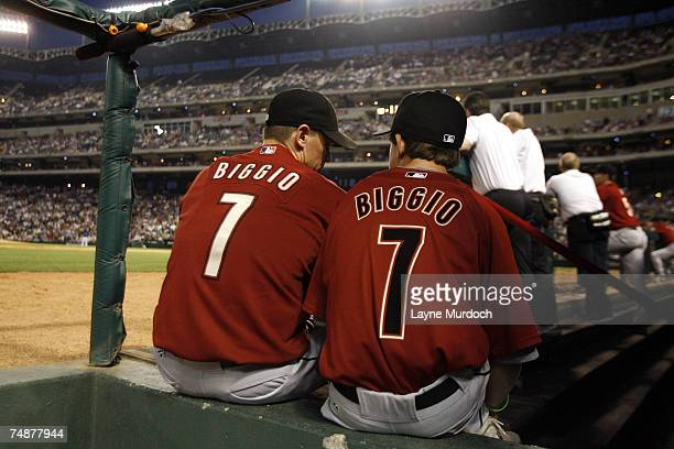 Craig Biggio of the Houston Astros shares a moment with his son Conor in the dugout against the Texas Rangers on June 24, 2007 at the Rangers...
