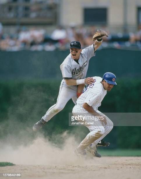 Craig Biggio, Second Baseman for the Houston Astros runs out Leo Gomez of the Chicago Cubs at second base during the Major League Baseball National...