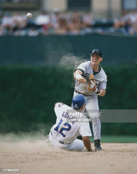 Craig Biggio, Second Baseman for the Houston Astros runs out Leo Gomez of the Chicago Cubs as he slides into second base during the Major League...
