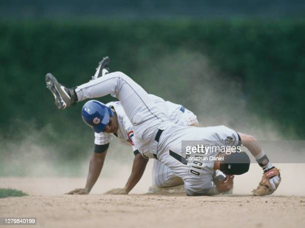 Craig Biggio, Second Baseman for the Houston Astros runs out Ozzie Timmons of the Chicago Cubs at second base during the Major League Baseball...