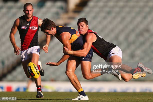 Craig Bird of the Bombers tackles Mark LeCras of the Eagles during the NAB Challenge AFL match between the West Coast Eagles and the Essendon Bombers...