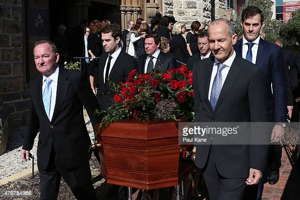 Craig Bond and John Bond lead the funeral prosession with the casket of their father Alan Bond following the service at St Patrick's Basilica on June...