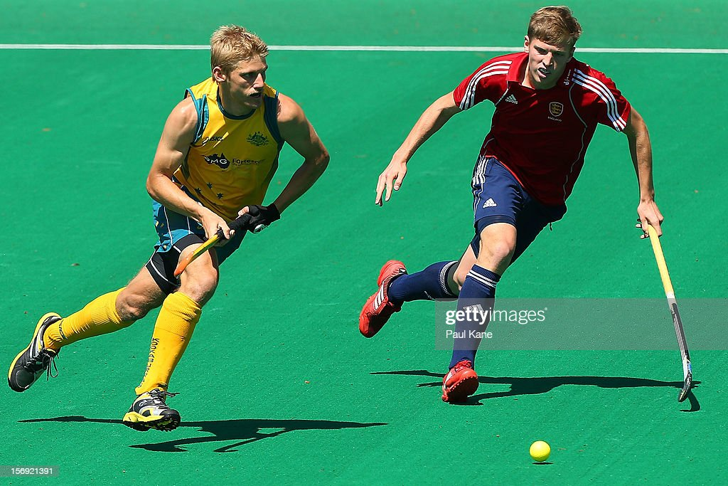 Craig Boyne of the Kookaburras looks to pass the ball against Oliver Willars of England in the gold medal match between the Australian Kookaburras and England during day four of the 2012 International Super Series at Perth Hockey Stadium on November 25, 2012 in Perth, Australia.
