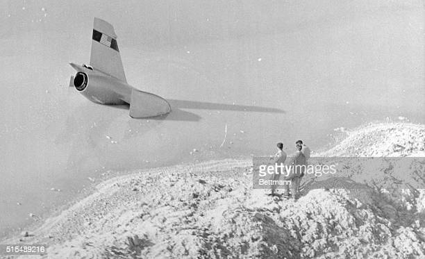 Craig Breedlove stands on a dike bank looking at his partially submerged jet racer after it spun out of control The crash came minutes after the...