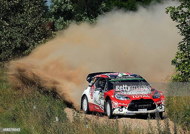 Craig Breen of Ireland and his codriver Scott Martin of Britain steer their Citroen DS3 WRC during the special stage at tyhe Rally Poland in...