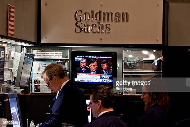 Craig Broderick chief risk officer of Goldman Sachs Group Inc appears on a television screen as traders work on the floor of the New York Stock...