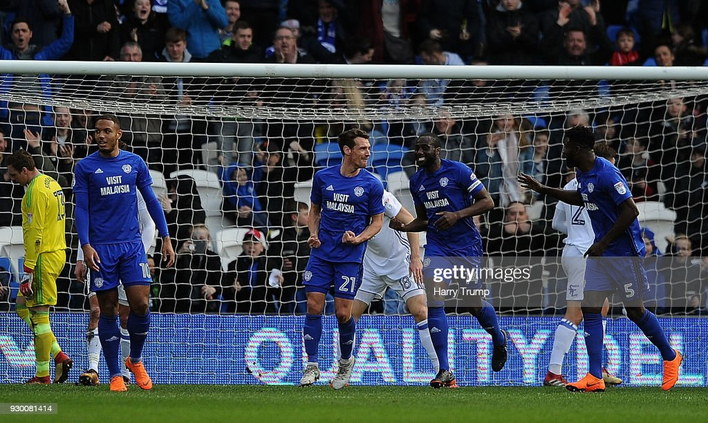 Craig Bryson of Cardiff City(C) celebrates after scoring his sides second goal during the Sky Bet Championship match between Cardiff City and Birmingham City at the Cardiff City Stadium on March 10, 2018 in Cardiff, Wales.
