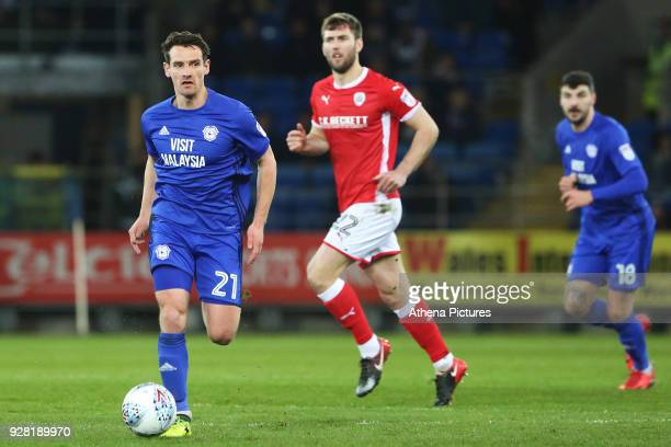 Craig Bryson of Cardiff City is marked by Gary Gardner of Barnsley during the Sky Bet Championship match between Cardiff City and Barnsley at the...