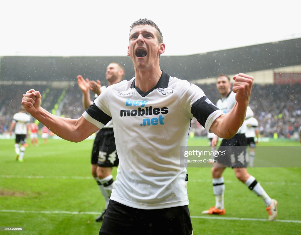 Craig Bryson of Derby County celebrates his third goal from the penalty spot during the Sky Bet Championship match between Derby County and Nottingham Forest at iPro Stadium on March 23, 2014 in Derby, England.