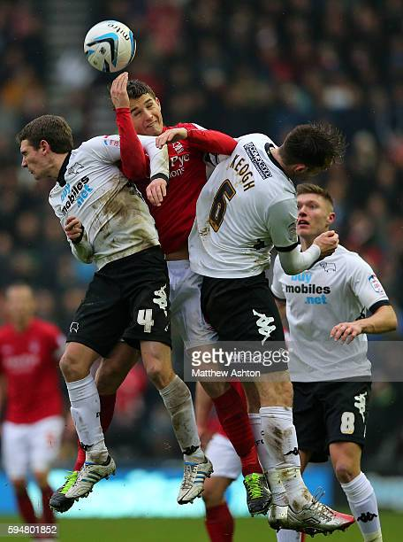 Craig Bryson of Derby County Chris Cohen of Nottingham Forest and Richard Keogh of Derby County