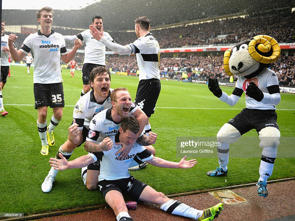 Craig Bryson of Derby County is mobbed after scoring from the penalty spot during the Sky Bet Championship match between Derby County and Nottingham Forest at iPro Stadium on March 23, 2014 in Derby, England.