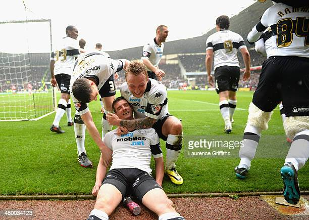 Craig Bryson of Derby County is mobbed after scoring his third goal from the penalty spot during the Sky Bet Championship match between Derby County...