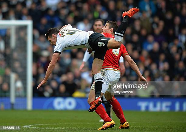 Craig Bryson of Derby County is tackled by Chris Cohen of Nottingham Forest during the Sky Bet Championship match between Derby County and Nottingham...