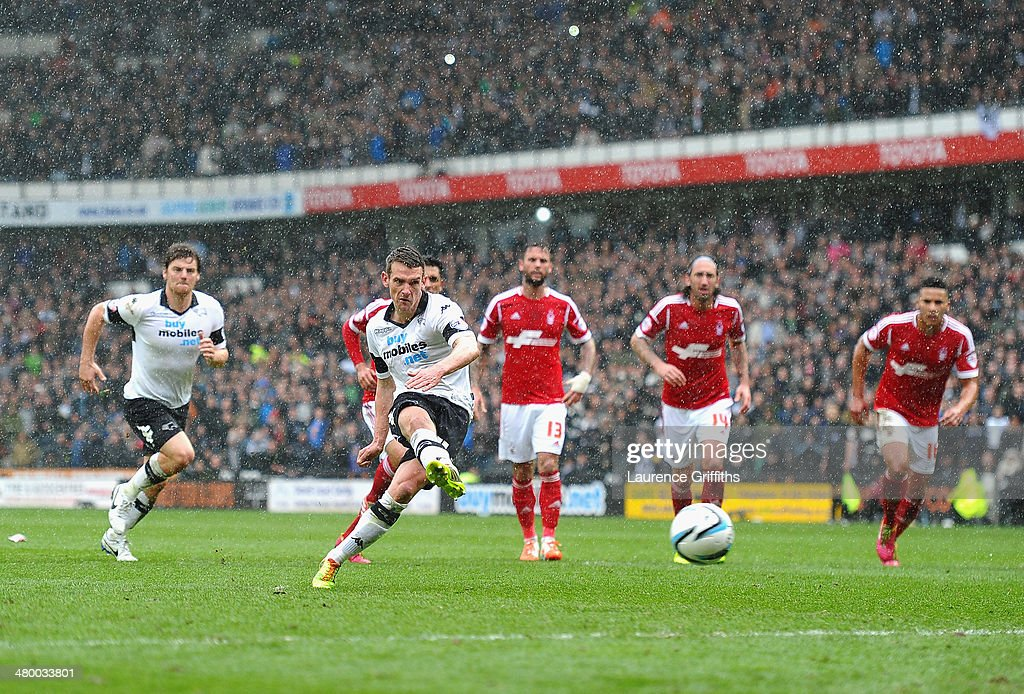Craig Bryson of Derby County scores from the penalty spotduring the Sky Bet Championship match between Derby County and Nottingham Forest at iPro Stadium on March 23, 2014 in Derby, England.