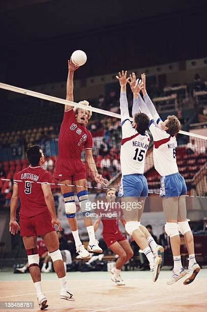 Craig Buck of the United States returns against Rob Grabert and Jan Posthuma of the Netherlands during their Men's Volleyball match on 24th September...