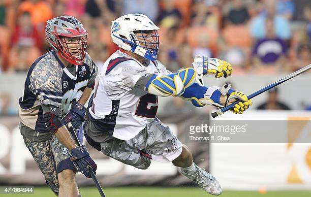 Craig Bunker of the Gladiators scores as he is defended by Mitch Belisle of the Cowboys in the second half during the 2015 MLL All Star Game on June...