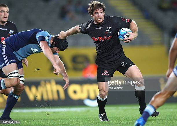 Craig Burden of the Sharks fends off Ali Williams of the Blues during the round eight Super Rugby match between the Blues and the Sharks at Eden Park...