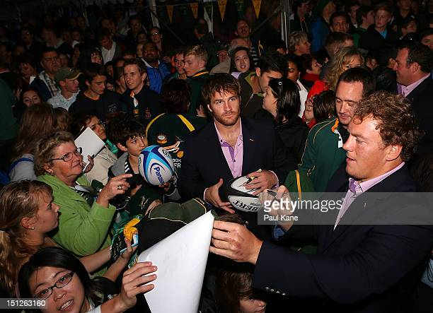 Craig Burden signs autographs for fans during the Big Braai at Northbridge Piazza on September 5 2012 in Perth Australia